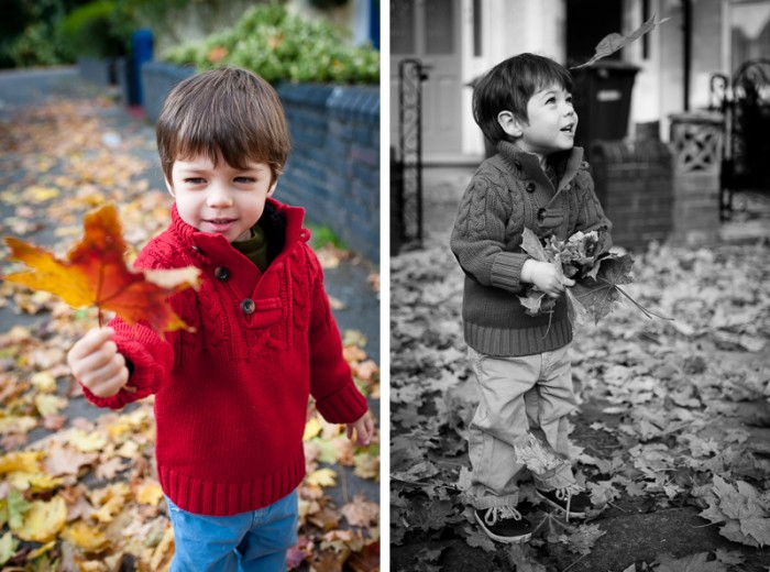 Boy playing in autumn leaves during kids portrait session