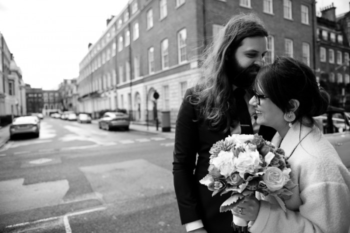 Bride and groom laughing during London wedding