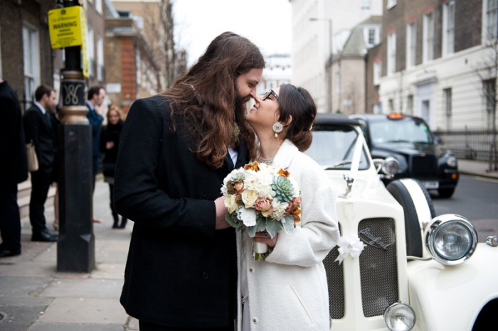 Bride and groom outside Asia House in front of vintage car