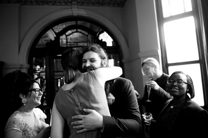 Groom greeting guests at Crocker's Folly wedding in London