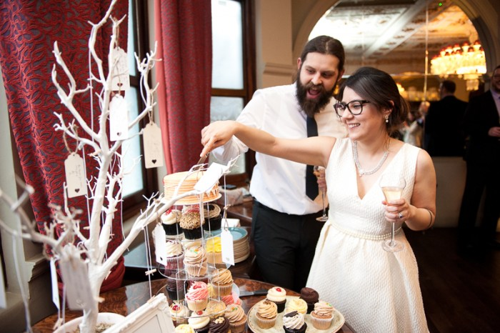 Bride and groom cutting vegan wedding cake at London pub