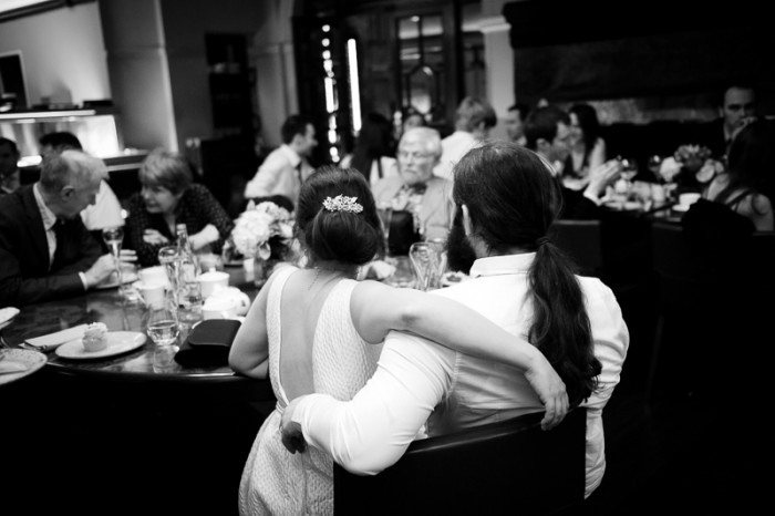 Documentary photograph of bride and groom having during wedding breakfast at Crocker's Folly