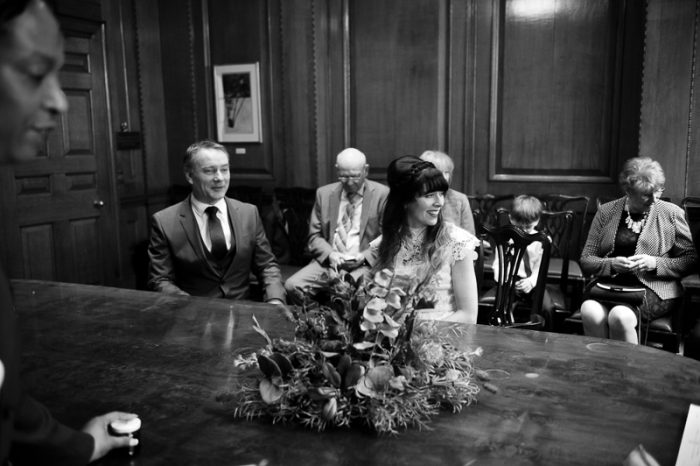 Black and white photograph of bride and groom during Camden Hall wedding