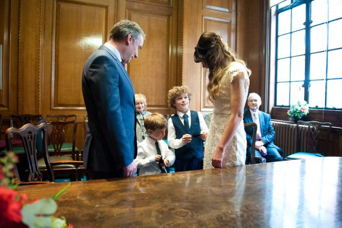 Documentary-style wedding photo of Camden Hall wedding ceremony