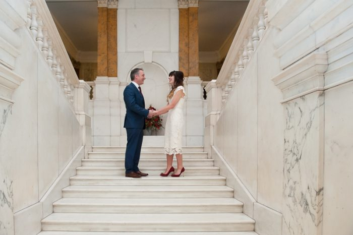 Bride and groom on marble staircase at Camden Hall wedding