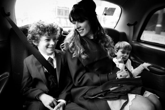 Bride with her two sons in taxi on the way to wedding reception