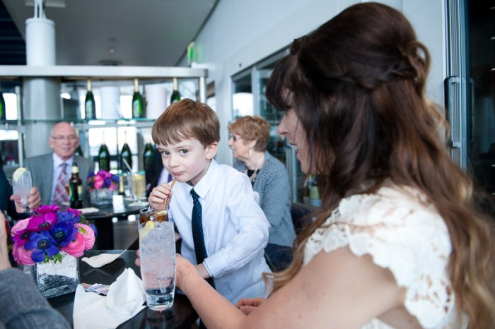 Boy having a drink at the Oxo Tower during a London winter wedding