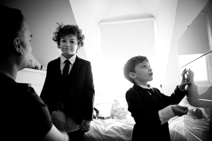 Little boys getting ready for their parents' winter wedding in London