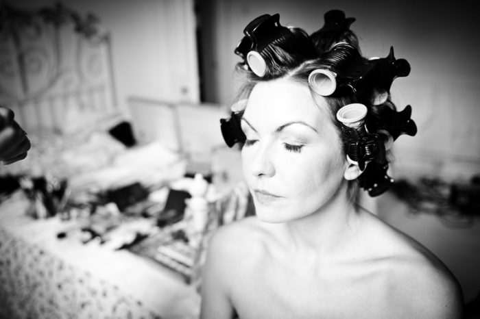 Black and white portrait of bride during bridal preparations