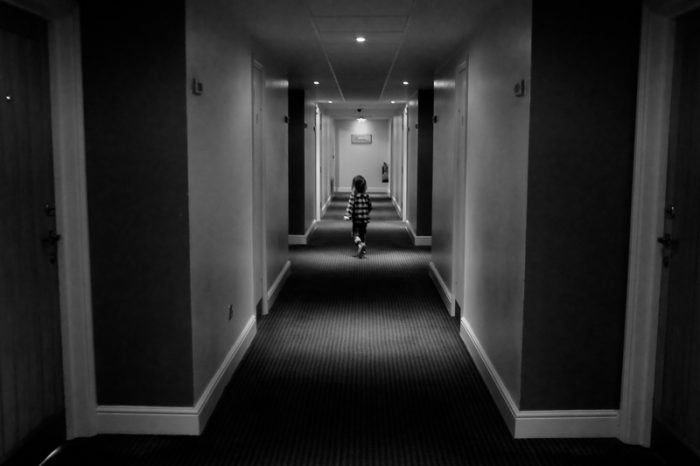Boy in hotel corridor