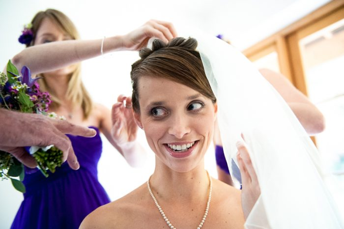 Bride putting on veil for Bartholomew Barn wedding