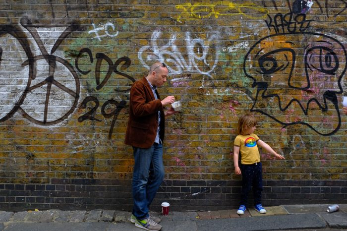 Father and son hanging out in Brick Lane