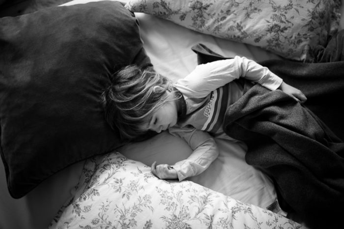 Black and white picture of child sleeping