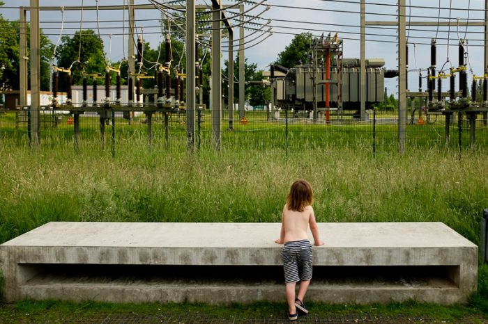 Boy looking at powerstation
