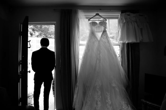 Black and white photo of father of the bride and wedding dress