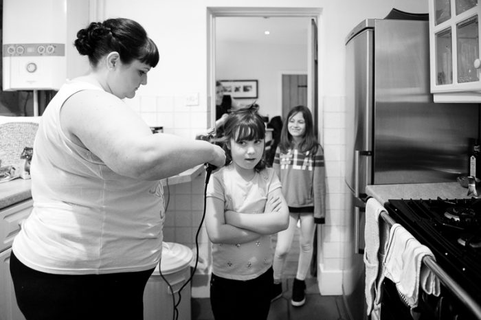 Black and white photo of flower girl getting ready for the big day