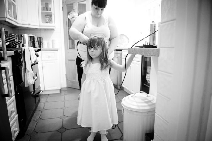Flower girl getting her hair done for Surrey wedding