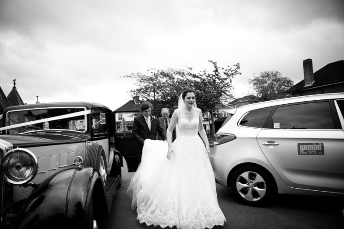 Bride getting out of the car at Englefield Green