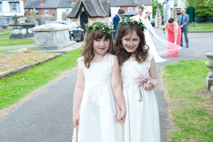 Flower girls walking up to Greek Orthodox church