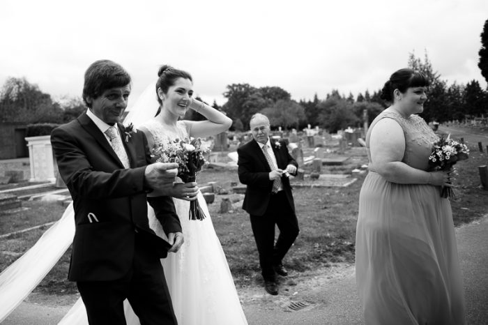 Bride and Dad walking up to Greek Orthodox Church in Englefield