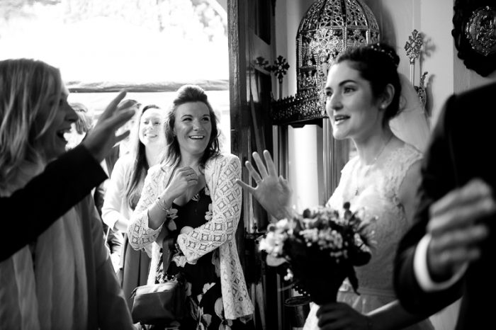 Bride greeting guests at Greek Orthodox wedding