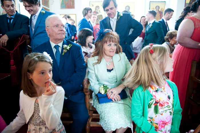 Photograph of guests at Greek Orthodox wedding in Surrey