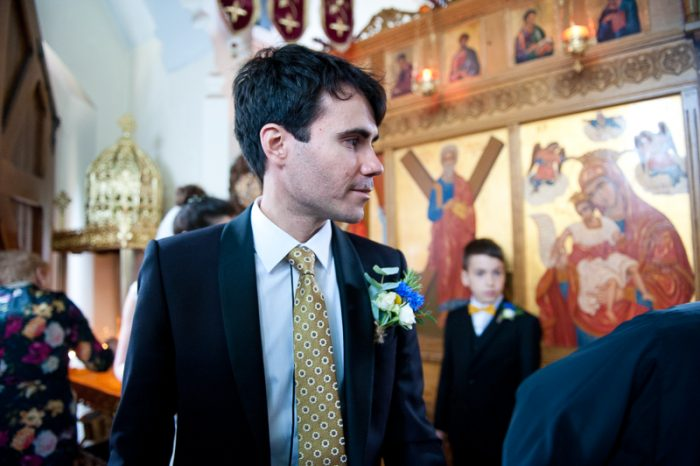 Groom at Greek Orthodox wedding ceremony
