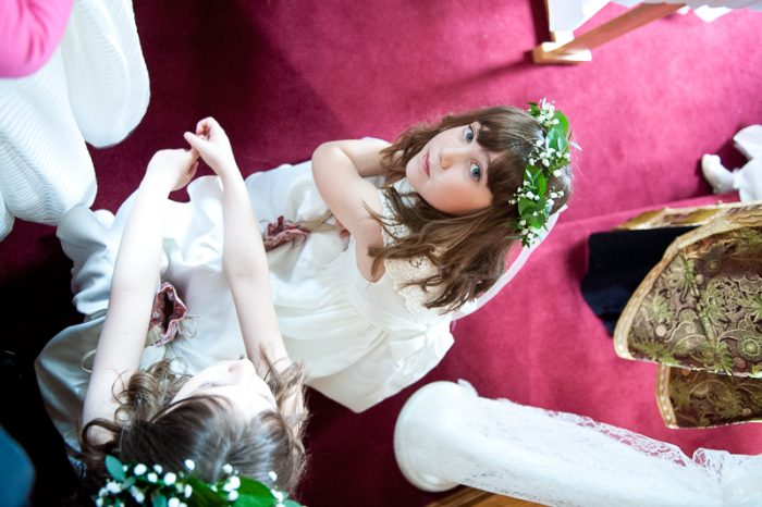 Flower girls at Greek Orthodox wedding ceremony