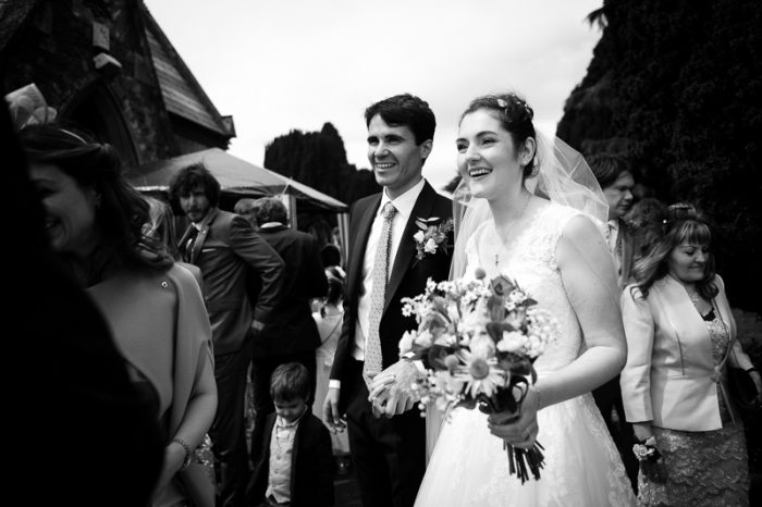 Bride and groom outside the church in Englefield Green