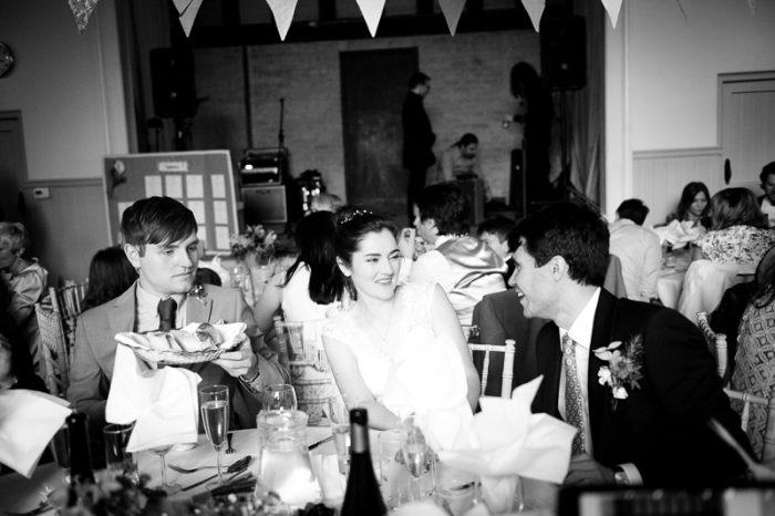 Bride and groom at wedding breakfast at Lyne Village Hall