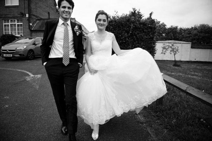 Bride and groom couple portrait at Lyne Village Hall