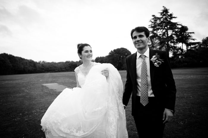Black and white portrait of bride and groom at Lyne Village Hall in Surrey