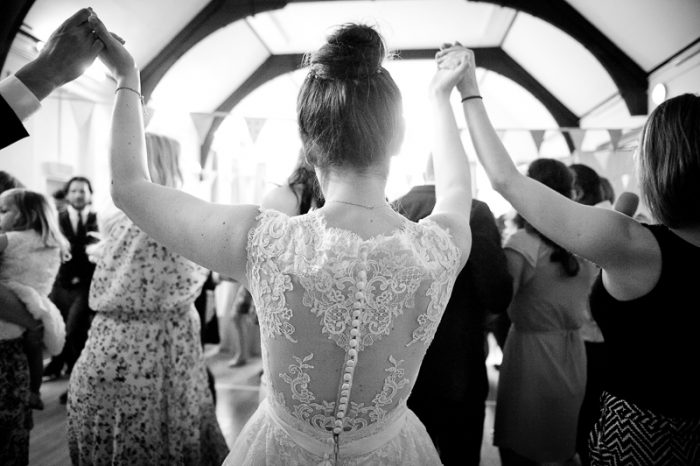 Bride dances at Greek wedding