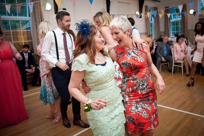 Wedding guests enjoying the dancing at village hall wedding