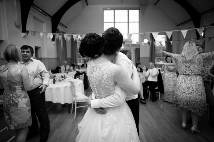 Bride and groom dancing together at Lyne Village Hall wedding