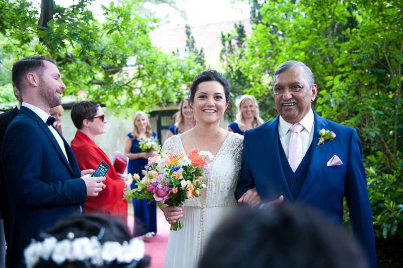 Bride walking up the aisle with father at Humanist wedding