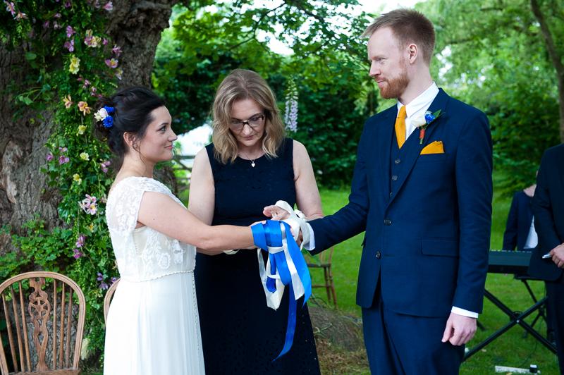 Hand fastening during humanist wedding ceremony