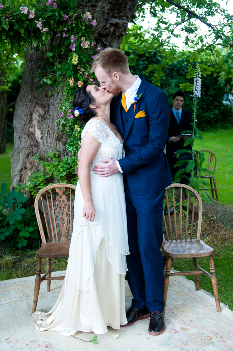 Bride and groom kissing during humanist wedding
