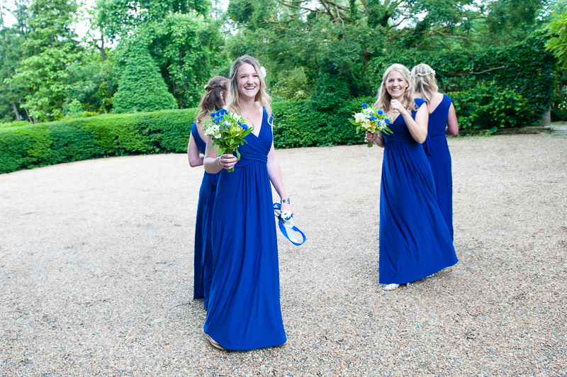 Bridesmaids in blue maxi dresses
