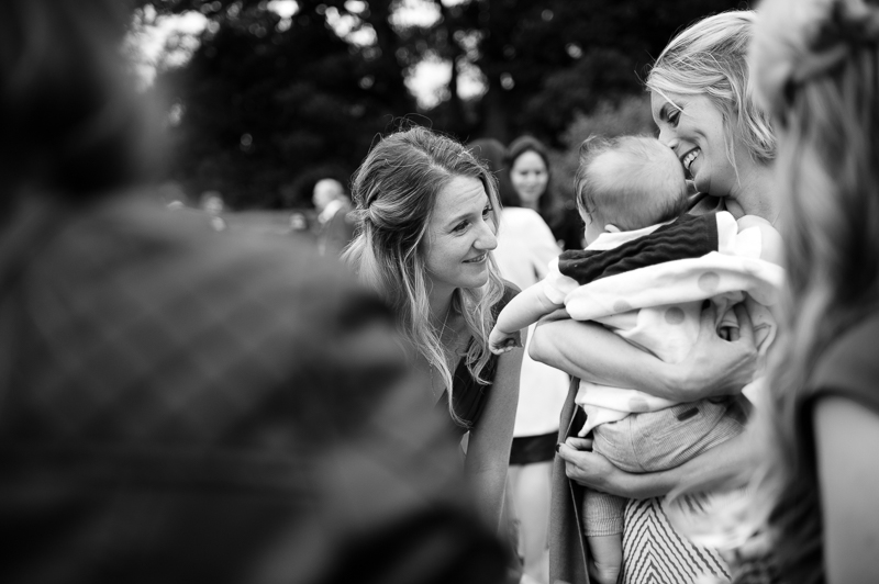 Bridesmaid greeting baby at Ridge Farm wedding