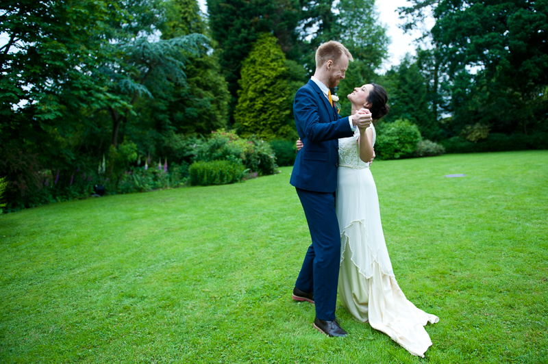 Bride and groom dancing in the garden at Ridge Farm wedding