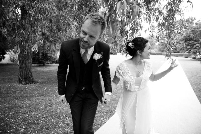 Bride and groom walking into wedding breakfast at Humanist wedding