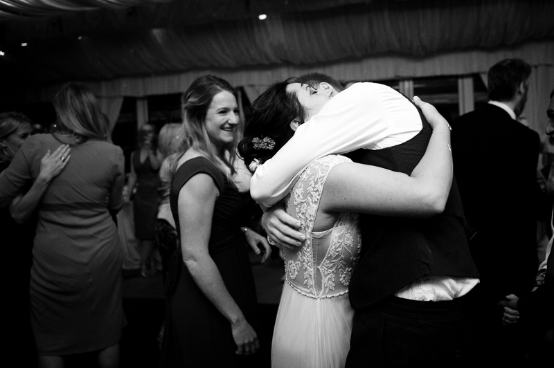 Bride and groom hugging on the dancefloor