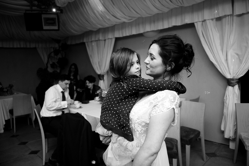 Bride and little girl dancing at Ridge Farm