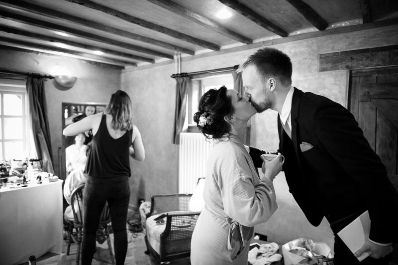 Bride and groom kissing at Ridge Farm