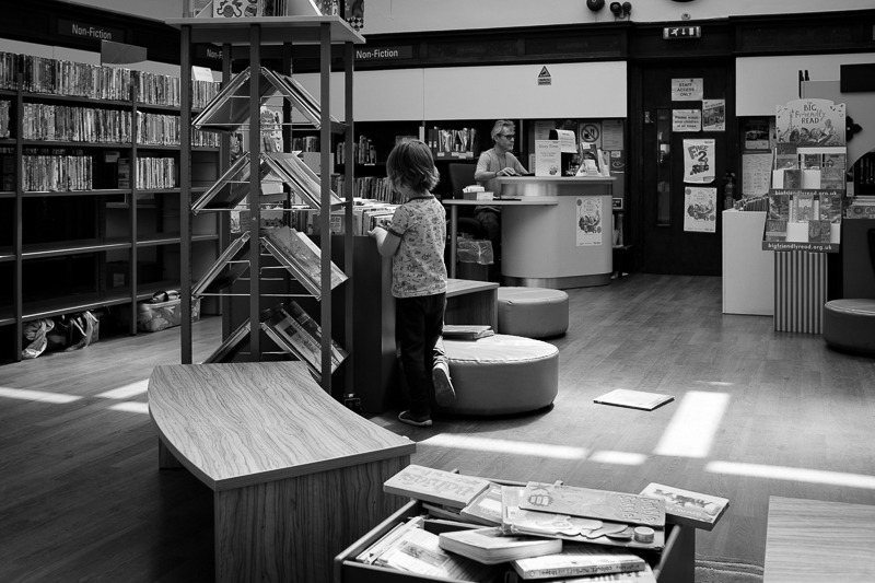 Boy playing in the library in Muswell Hill