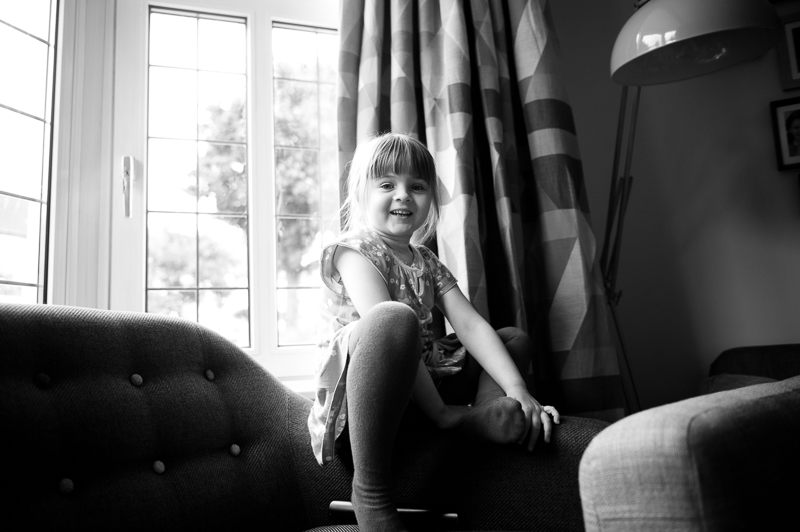 Black and white photo of little girl at family portrait session in Palmers Green