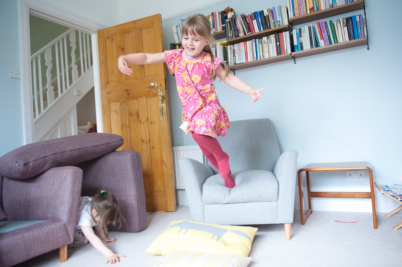 Girl jumping off chair at Palmers Green Family Photography session
