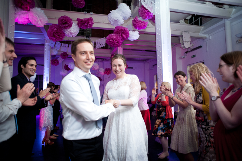 Bride and groom joining in a Ceilidh at Stoke Newington wedding