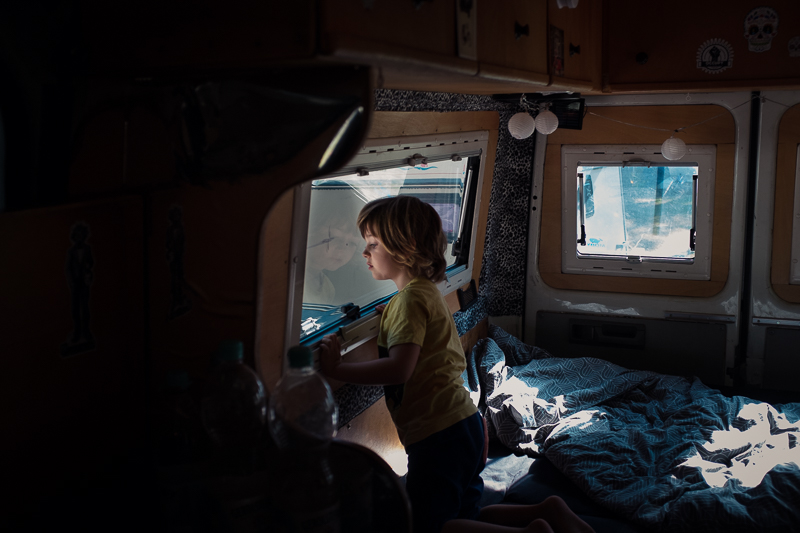 Child in camper van looking out